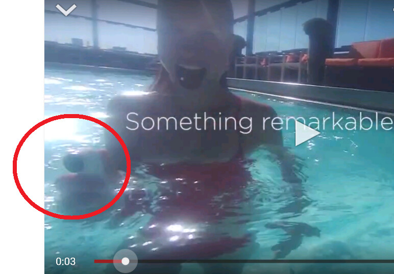 """Is that HTC's rumored new camera in the swimmer's hand? - HTC video teases October 8th event; """"something remarkable is coming"""" (Picture shows device)"""