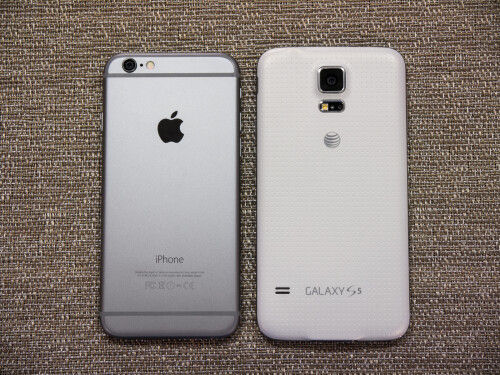 samsung s5 vs iphone 6 apple iphone 6 vs samsung galaxy s5 vote for the better 6184