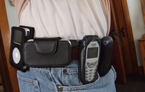 Now that our smartphones are basically an all-in-one device, with less of a need for two phones, accessorizing your belt like this is a thing of the past, thankfully - Bending phones, pocket explosions, butt-dialing: it's time for the old belt-holster to make a comeback
