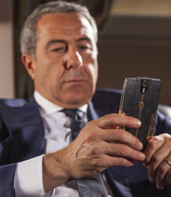 An elegant gentleman enjoying Android 4.4.4 KitKat on the $6,000 handset