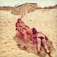 italys-salvatore-calafato-captures-a-couple-lounging-on-a-beach.jpg