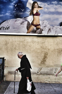 a-priest-walks-by-a-risqu-advertisement-in-this-photo-by-emanual-faria-of-portugal.jpg