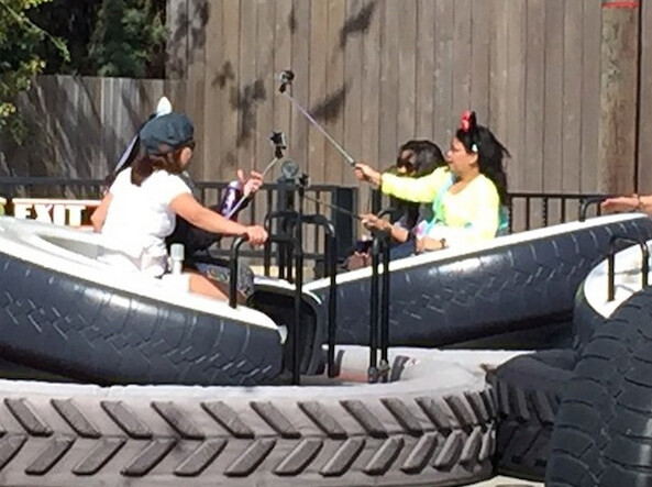 Selfie sticks used at Disneyland on Luigi's Flying Tires ride - Disney bans selfie sticks from rides and attractions at its parks