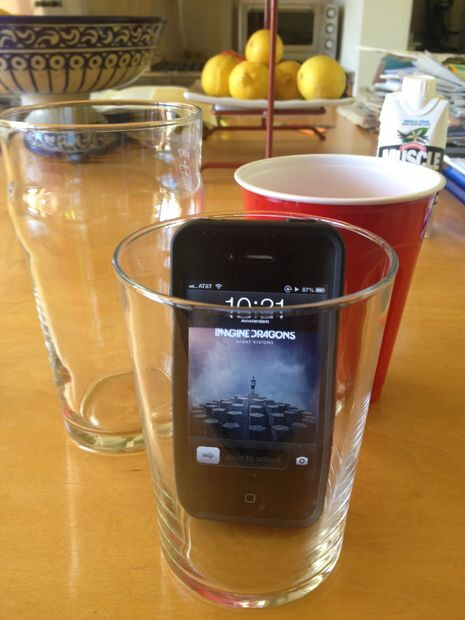 Place phone in a cup to boost its volume
