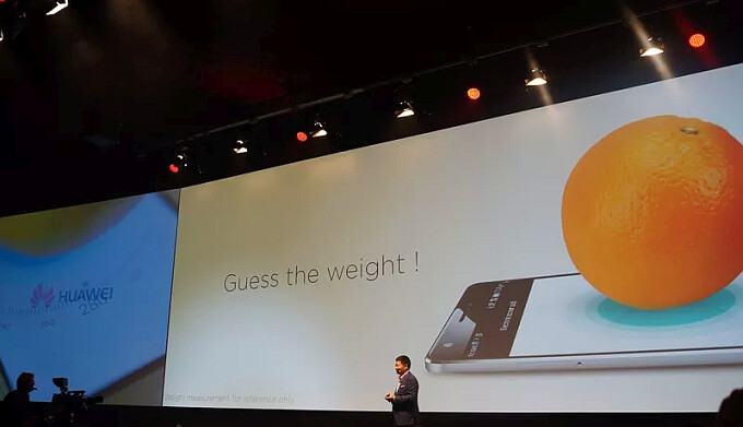Huawei trolls Apple, weighs an orange to show off the pressure-sensing display on the Mate S