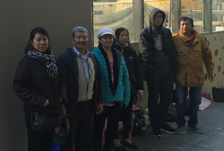 Six Vietnamese neighbors who live in San Francisco, wait outside the local Apple Store for Friday's iPhone launch - Lines forming by Apple Stores for Friday's launch of the Apple iPhone 6s and Apple iPhone 6s Plus
