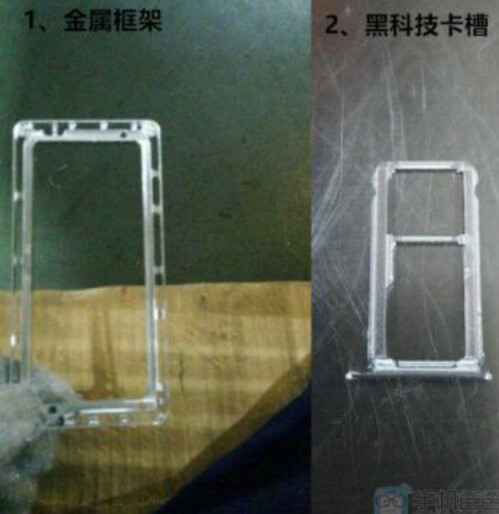 Metal frame for the Mate 8 at left with the SIM card tray on right