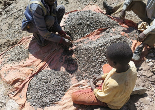 13-year old Charles sorts stones with his dad and sells the ore to traders