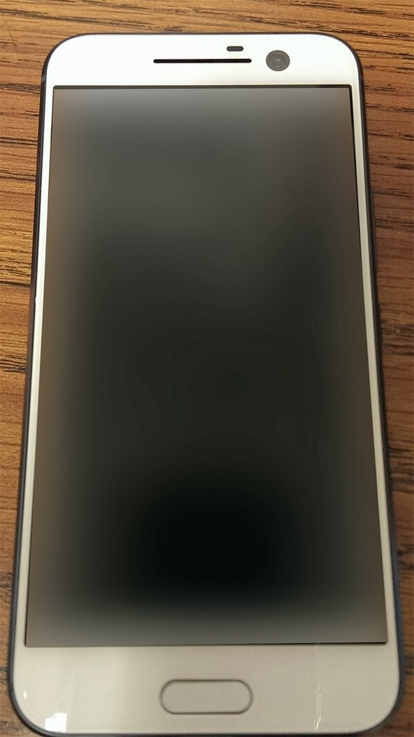 HTC One M10 in white smiles for the camera in fresh leak