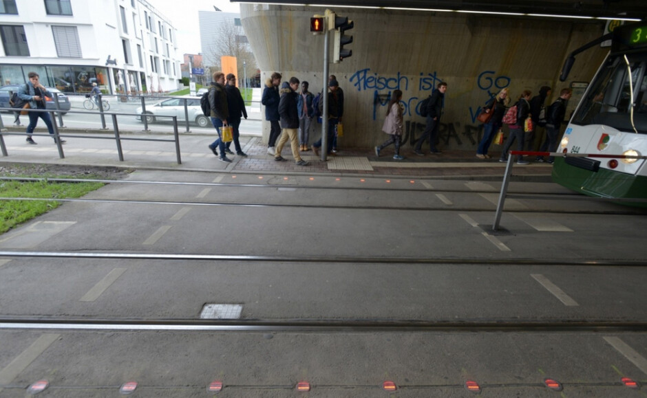 In the German city of Augsburg, traffic lights are embedded into the sidewalk for those who text and walk - German city caters to those who text and walk by placing traffic lights in a unique location
