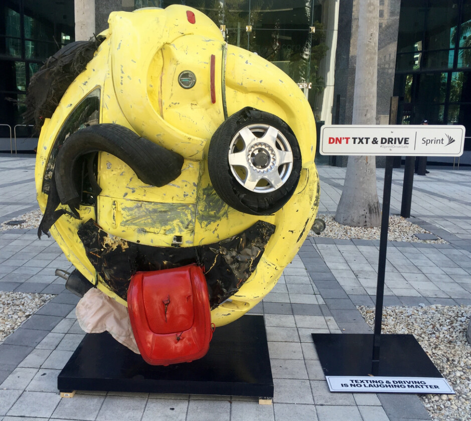 Sprint's new sculpture is supposed to make you think twice about texting and driving - Sprint unveils car crash sculpture in Miami to scare those who text and drive