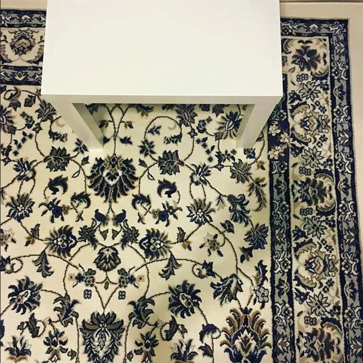 Can you find the iPhone, ensconced in a floral case, lost in the carpet? - Can you spot the Space Gray iPhone that is lost on this carpet?