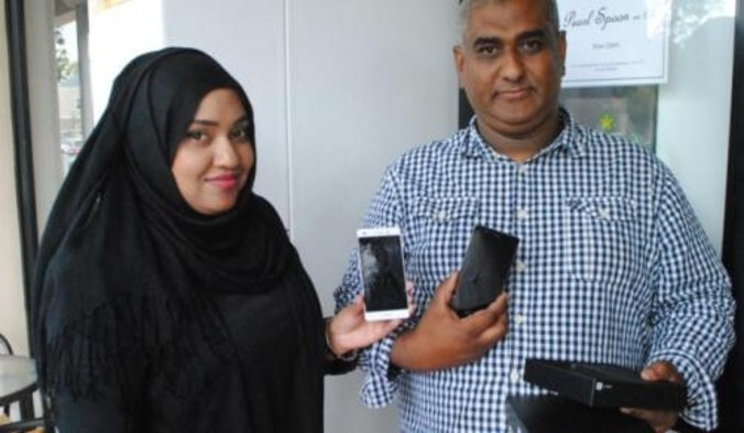 Huawei's Hawa Hyath (L) presents Siraaj Abrahams with a Huawei P9 lite - Huawei P8 lite takes two bullets for its owner; company responds with a free upgrade to the P9 lite