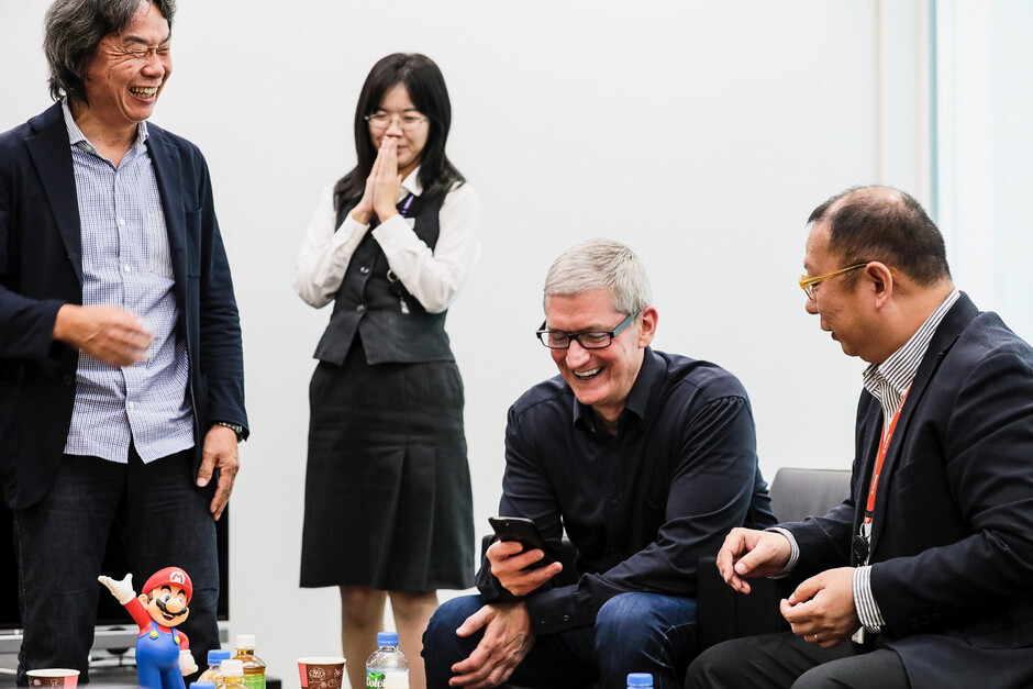 As Mario creator Shigeru Miyamoto (at left) looks on, Apple CEO Tim Cook previews Super Mario Run for iOS - Tim Cook meets Nintendo executives in Japan, gets to play a preview of the first Mario iOS game