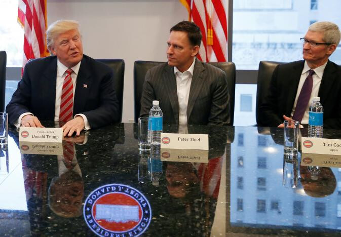 """Trump supporter and Hedge Fund manager Peter Thiel sits in between the President-elect and Apple CEO Tim Cook during Wednesday's tech summit in New York - Tech executives have """"productive"""" meeting with the President-elect and his family on Wednesday"""