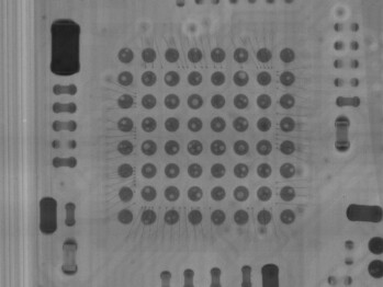 The tiny air bubbles can be seen as white spots on the soldering joints of this X-ray photo of one of the microcontrollers.