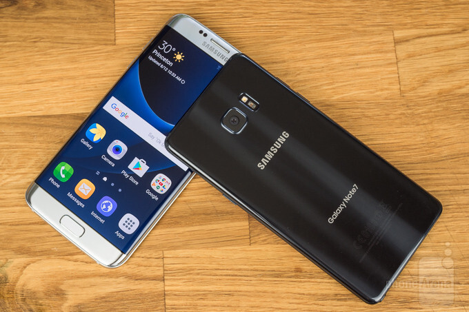 Samsung shares hit record high, but the company slashes bonuses for the mobile division
