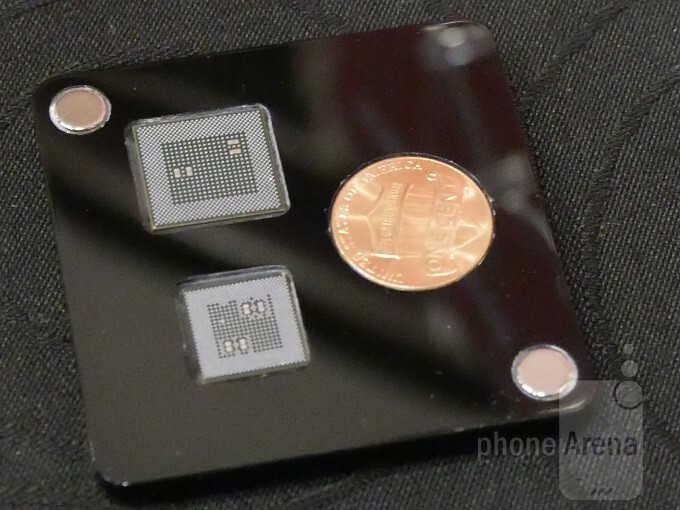 Up top, the Snapdragon 820. Below, the new Snapdragon 835, and a penny. - We get an up-close look at Qualcomm's new 835 Snapdragon CPU