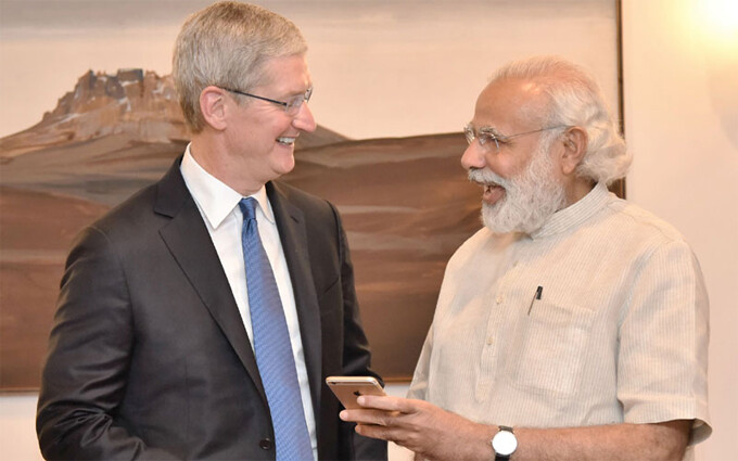 Apple CEO Tim Cook and Indian PM Narendra Modi - Apple preparing to enter talks with Indian government on opening local manufacturing plant