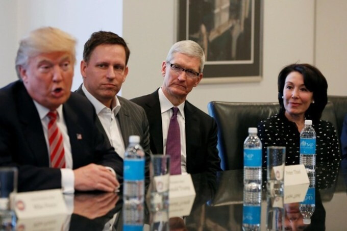 """Peter Thiel sitting between the President-elect and Apple CEO Tim Cook at Donald Trump's tech summit - Silicon Valley billionaire says """"the age of Apple is over"""""""