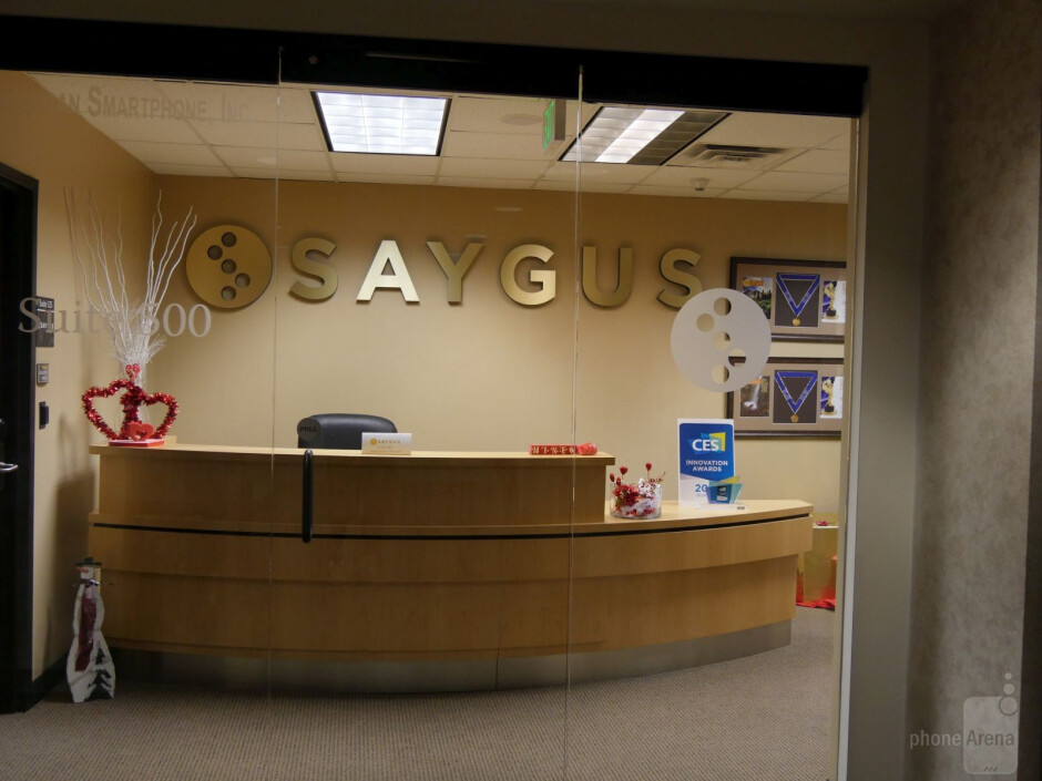 After lunch and the middle of the work week, an empty receptionist desk greeted me. Was Saygus open for business? Yes, although a beehive of activity, the offices were not. - Remember Saygus? We got an exclusive sit-down with founder and CEO Chad Sayers