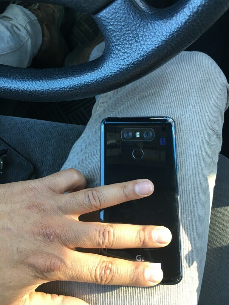 Click to zoom in - Photo of the LG G6 in the wild shows its glossy back
