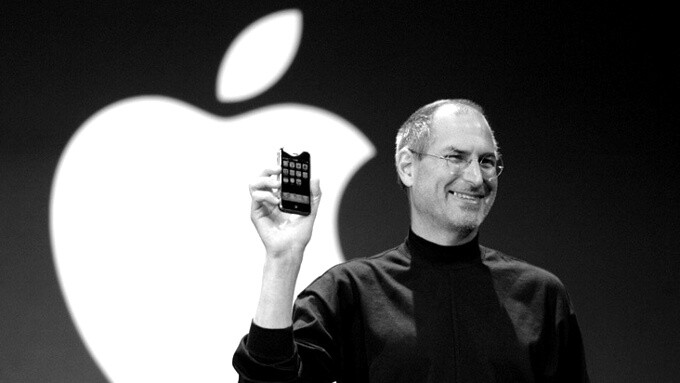 Steve Jobs holding the original iPhone - Apple iPhone vs Samsung Galaxy: a history of the biggest smart phone rivalry
