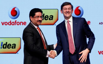 Kumar Mangalam Birla (left), chairman of Aditya Birla Group, shaking hands with Vittorio Colao (right), CEO of Vodafone Group, following the announcement of the merger between the two companies