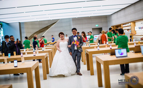 Couple in Singapore get married, pose for post-ceremony photos inside the country's lone Apple Store