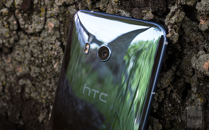 Squint hard enough and you'll see a bunch of smiling HTC executives in the phone's reflection - HTC's revenues are on the rise, and it's all thanks to the U11