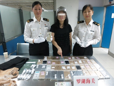 Smuggler caught with 102 iPhones strapped to her body