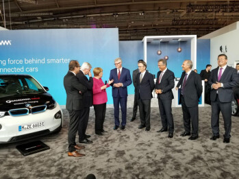 Qualcomm CEO Steve Mollenkoptf at the Frankfurt Auto Show, fourth from left