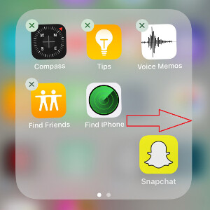 Drag the icon to the edge of a folder page