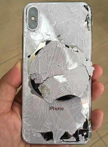 Back glass of an Apple iPhone X is shattered after the phone was dropped