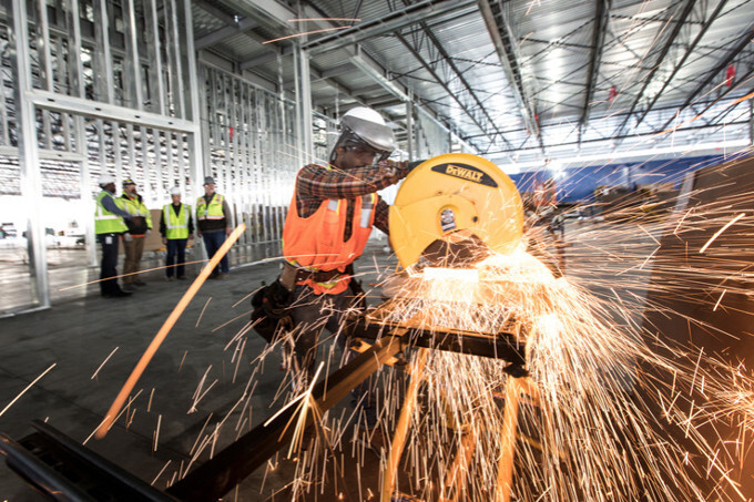 Sheet metal cutting for the new Apple data center in Reno - Apple to pay the largest ever amount in offshore taxes, contribute $350 billion to the US economy