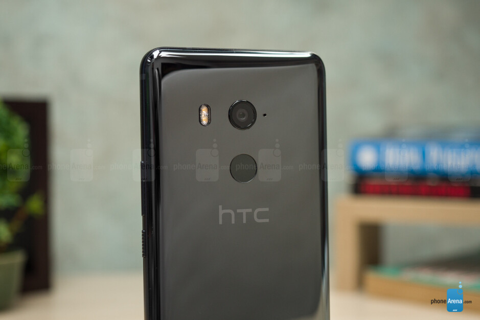 HTC opted to go with a metal meets glass design with its most recent phones, the HTC U Ultra, U11, and U11+. - A look back at the evolution of HTC's smartphone designs