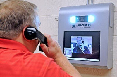 A Securus video phone used in prison - NYT: Data sharing service helps law enforcement track any cellphone in seconds