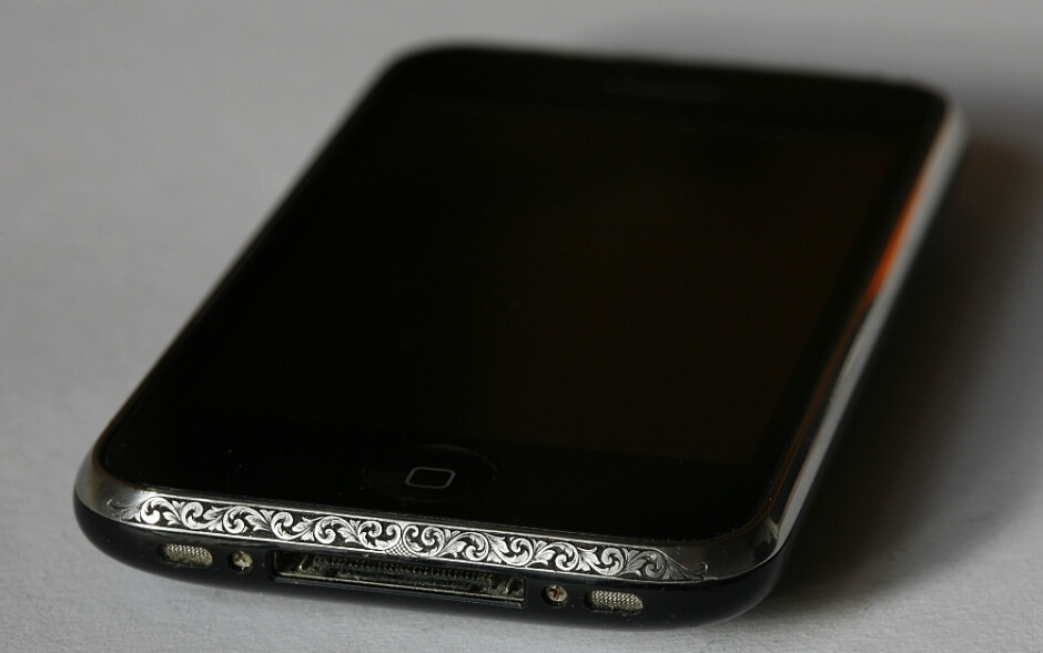 Personalized hand-engraving adds some elegance to an older iPhone