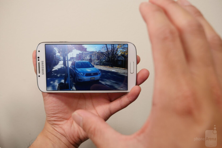 Why scroll using your finger when you can do the same by waving your hand over and over the display? - Most useless software features in Samsung's past smartphones