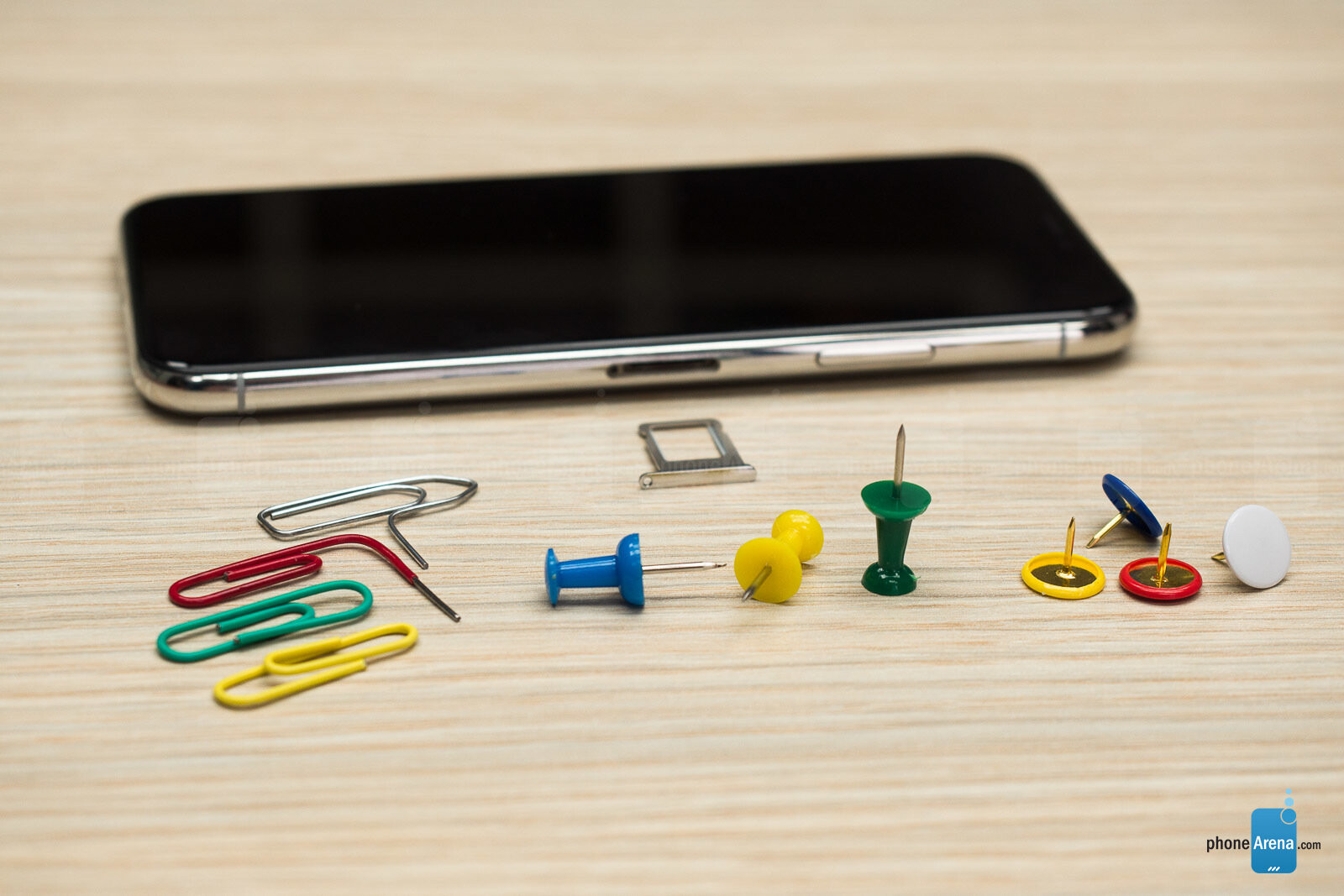 How to open a SIM card tray when an ejector tool isn't