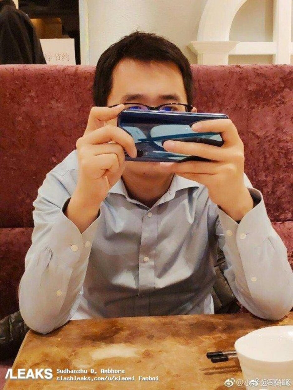Photo allegedly shows the Xiaomi Mi 9, set to be unveiled later this month - Photo leaked by Xiaomi executive shows triple camera setup for Mi 9