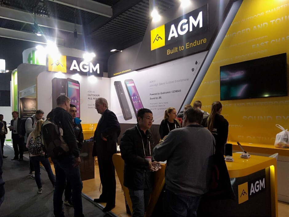 AGM booth at MWC - AGM is at MWC: super-durable phones coming to Europe, partnered with JBL for superior audio