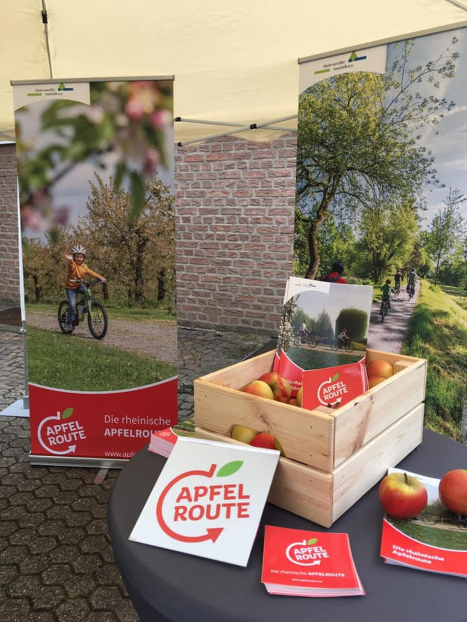 The Apfelroute marketing materials are all ready for the grand opening on May 18 - Bitten fruit and right-leaning leaf do not an Apple logo make (results)