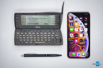 A Nokia 9110i Communicator next to an iPhone XS Max