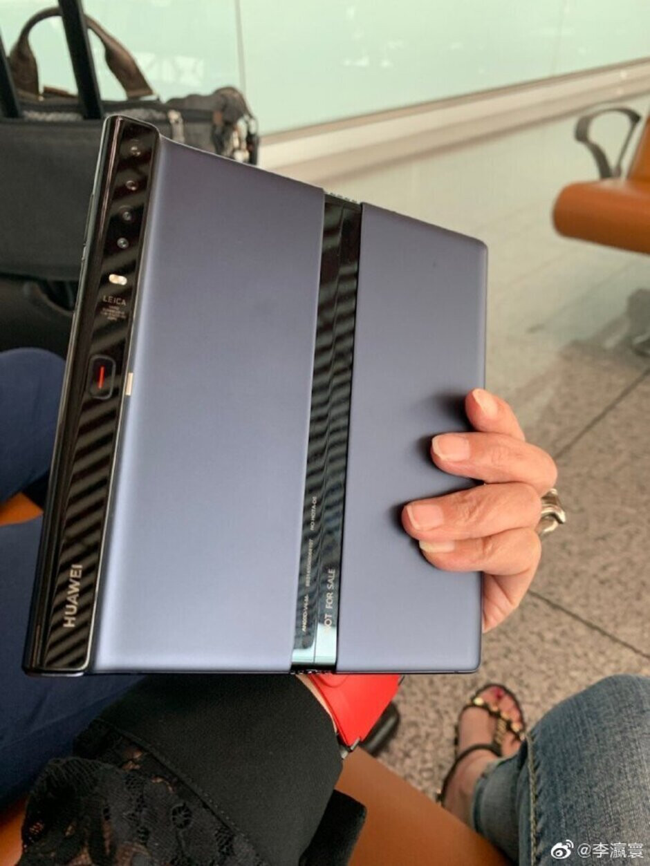 This is what the back of the Huawei Mate X looks like now - Photos show Huawei executive holding redesigned Mate X