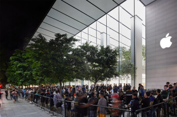 Apple fans waiting in line to buy the latest iPhone - Why do people hate Apple?