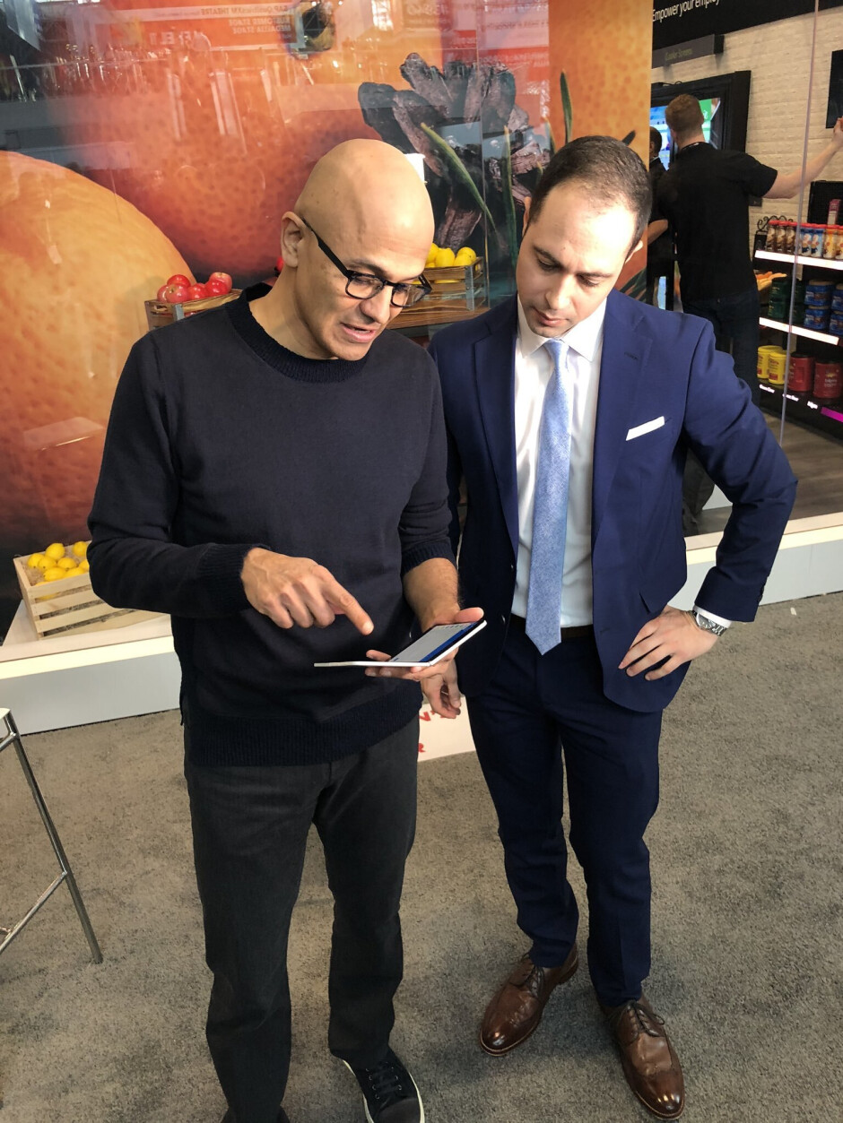 Microsoft CEO Satya Nadella showing off his Surface Duo device - Dual-screened Surface Duo gets photo opp with Microsoft's CEO Nadella