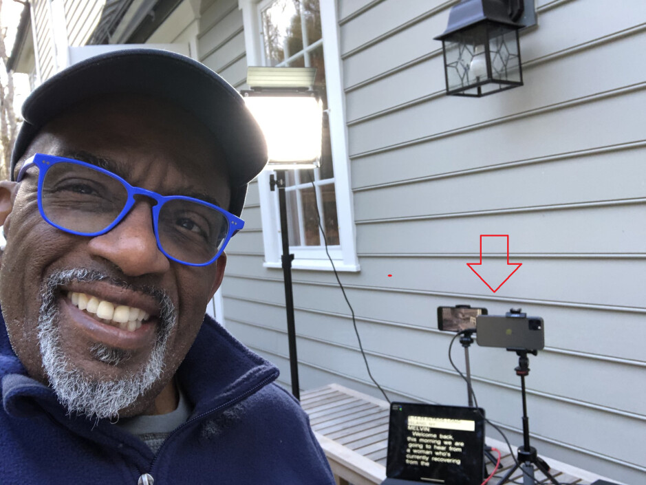 NBC's Al Roker poses with the iPhone units and the iPad he uses to broadcast live from outside his home - Three iOS devices allow Al Roker to broadcast live from home