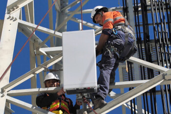 Ericsson engineers work on a cell tower - U.S. still looking at ways to create a challenger to Huawei for 5G gear