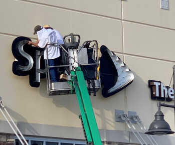 The Sprint name comes off one of its former stores - T-Mobile starts to close and rebrand Sprint stores says its construction director